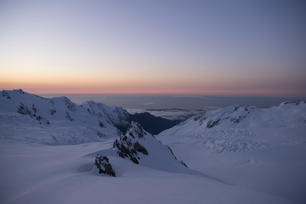 Looking down onto the Davis snowfield from Centennial Hut, photo by Mark Watson